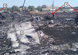 Main wreckage site showing engine parts (1), wing with inspection hatches (2) and main landing gear (3).<br />Source: NBAAI